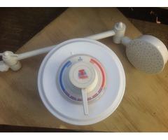 Topliss shower mixer and adjustable shower rose.