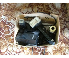 box of old camera gear, flashes etc